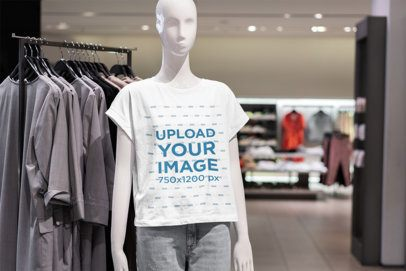 Mockup Featuring a Mannequin Wearing a Customizable T-Shirt at a Store 3710-el1