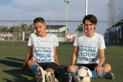 T-Shirt Mockup of Two Teenagers in a Soccer Field 33555