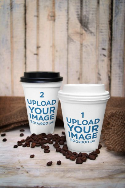 Mockup of Two Customizable Paper Cups Placed Surrounded by Coffee Beans 3753-el1