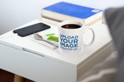 Mockup of an 11 oz Coffee Mug on a Nightstand 33670