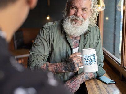 Mockup of a Joyful Senior Man Holding a 20 oz Beer Stein 33458