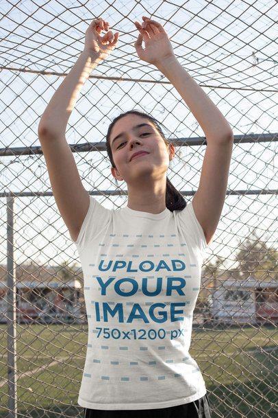 T-Shirt Mockup Featuring a Teen Posing by a Soccer Net 33564