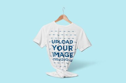 Mockup of a Customizable Tee on a Hanger Floating Against a Plain Color Backdrop 3713-el1