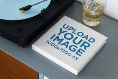 Mockup of a Squared Book Next to a Record Player 33907