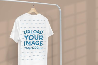 Minimal Apparel Mockup Featuring a Customizable T-Shirt Hanging From a Clothing Rack 3733-el1