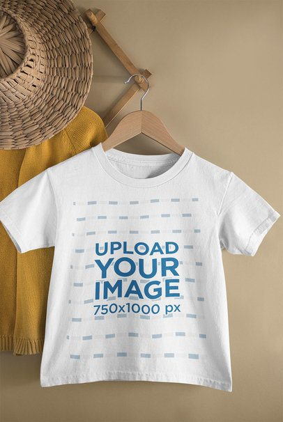 Mockup of a Kid's T-Shirt Hanging from a Wall Rack 33736