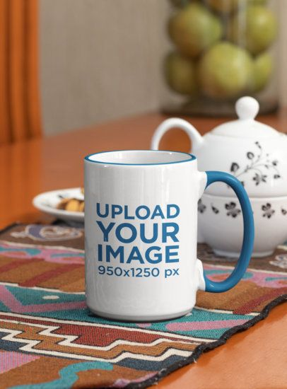 Mockup of a Customizable Rim Coffee Mug Next to a Porcelain Teapot 33809