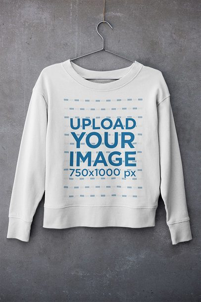 Mockup of a Sweatshirt Hanging Against a Concrete Surface 33982