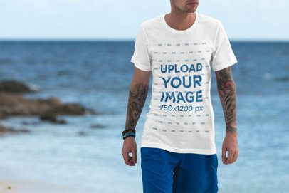 Mockup of a Man Wearing a T-Shirt Featuring the Sea in the Background 3325-el1