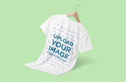 Minimal T-Shirt Mockup Featuring a Wooden Hanger and a Colored Backdrop 3722-el1
