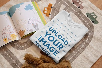 Mockup of a Folded T-Shirt on a Children's Room Mat 33995