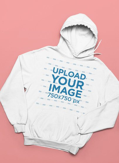 Mockup of a Pullover Hoodie Placed on a Customizable Surface 33899