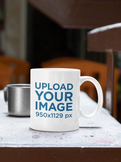 Mockup of an 11 oz Coffee Mug Placed on a Concrete Table 33818