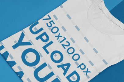 Mockup of a Folded T-Shirt Featuring a Customizable Background 33924