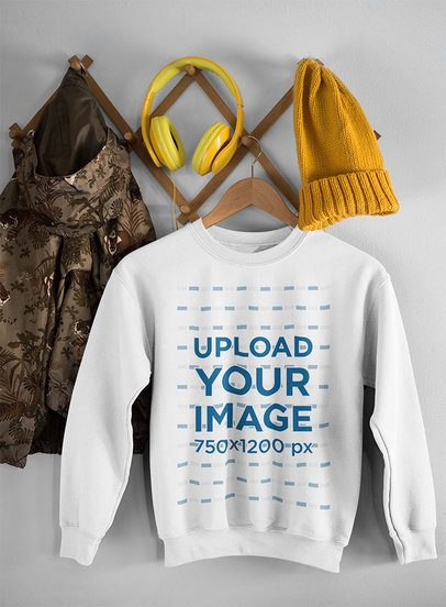 Mockup of a Crewneck Sweatshirt Hanging Along with Other Items 33992