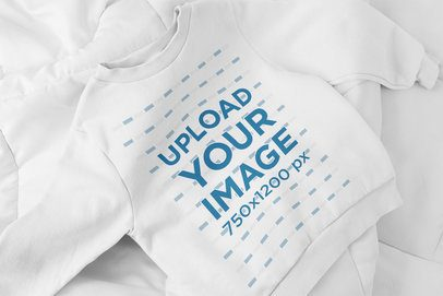 Mockup of a Crewneck Sweatshirt for Kids Placed on a Bed 33766