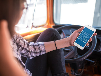 Woman in her Van Getting Ready to Drive with her White iPhone 6s in Portrait Position Mockup a12932wide