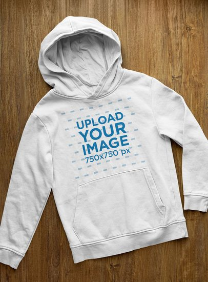 Mockup of a Pullover Hoodie Placed on a Wooden Surface 33877