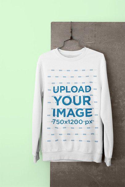 Crewneck Sweatshirt Mockup Hanging in a Minimalistic Setting 33980