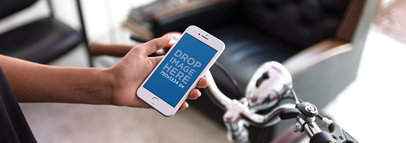 iPhone Mockup in Portrait Position Featuring a Man with a Bike in the Living Room 12964wide