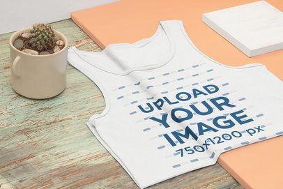 Mockup of a Folded Tank Top Featuring a Small Cactus 33969