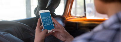 Girl Riding in the Frontseat of a Car with her Feet Up Holding an iPhone 6s in Portrait Position Mockup a12934w