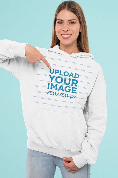 Mockup Featuring a Woman Pointing at Her Customizable Pullover Hoodie 31962