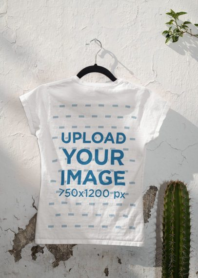 Mockup of the Back of a T-Shirt Hanging Next to a Cactus 33864