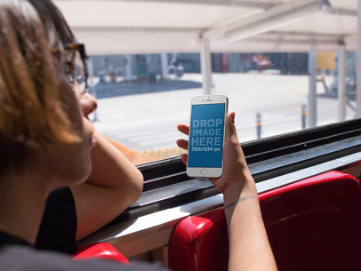 iPhone 6s Mockup in a Woman's Hand Who is Riding the Bus Home a12938w