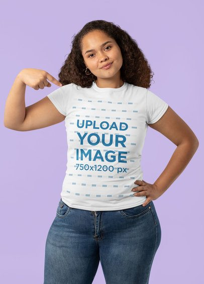 Mockup of a Woman in a Studio Pointing at Her T-Shirt 32005