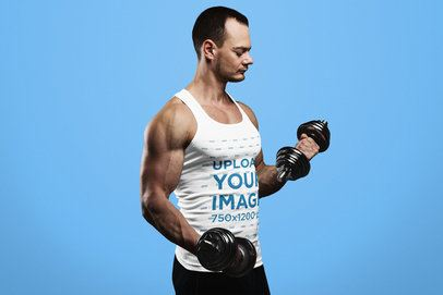 Mockup of a Muscular Man with a Tank Top Lifting Two Dumbbells 34071-r-el2