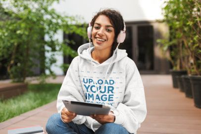 Mockup of a Young Woman with an Oversize Hoodie Listening to Music 34132-r-el2