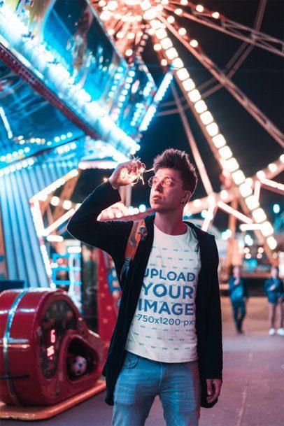T-Shirt Mockup of a Man Against a Ferris Wheel at Night 34256-r-el2