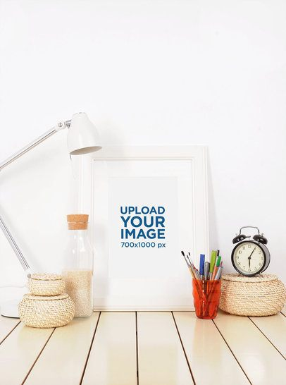 Mockup of an Art Print on a Desk Next to a Lamp 3962-el1
