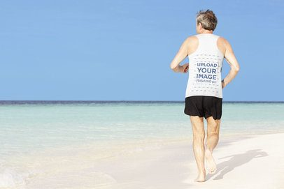 Back-View Mockup of a Senior Man Running by the Beach with a Tank Top 34193-r-el2
