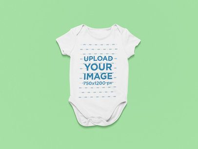 Mockup of a Short-Sleeve Onesie on a Customizable Surface 25737