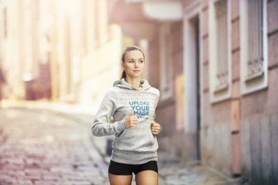 Pullover Hoodie Mockup of a Young Woman Jogging in the City 34078-r-el2