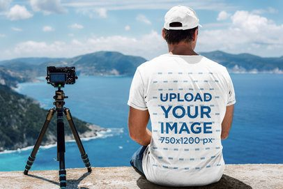 Back View T-Shirt Mockup of a Man with a Camera Contemplating the Ocean 34961-r-el2