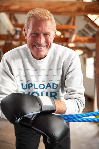 Sweatshirt Mockup Featuring an Elderly Man with Boxing Gloves 34211-r-el2