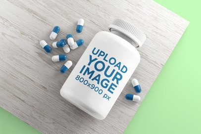 Pill Bottle Mockup Featuring Some Pills Around It 4045-el1