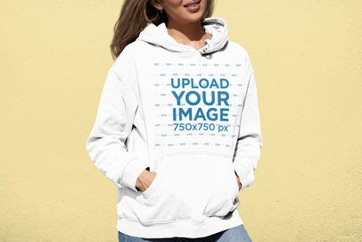 Mockup of a Woman Wearing a Pullover Hoodie Against a Flat Background 33884