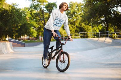 Sweatshirt Mockup of a Young Man Using an Acrobatic Bicycle 34013-r-el2