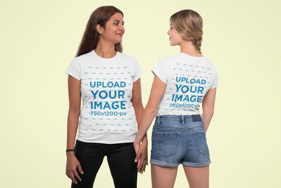Mockup Featuring Two Women Wearing T-Shirts and Looking at Each Other 31954