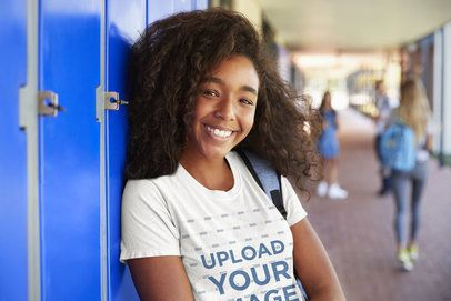 T-Shirt Mockup of a Smiling Student Posing by Some Lockers 34243-r-el2