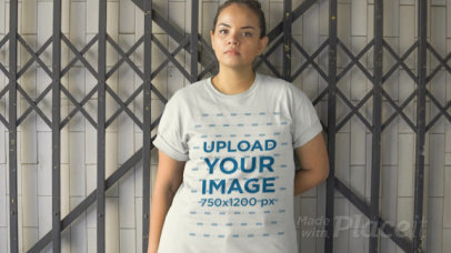 Plus Size T-Shirt Video of a Woman Leaning Against a Gate 12525