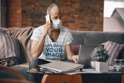 T-Shirt Mockup of a Man with a Face Mask Working From Home 34331-r-el2