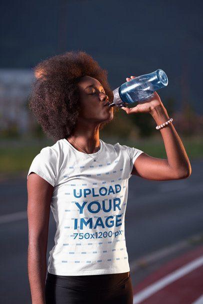 T-Shirt Mockup of a Woman Drinking Water at a Running Track 34373-r-el2