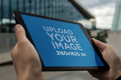 Mockup of an iPad Being Held in Landscape Position by a Man 2047-el1