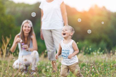 Tank Top Mockup Featuring a Little Kid Chasing Bubbles in a Garden 34188-r-el2