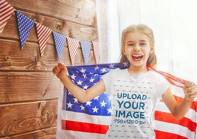 T-Shirt Mockup of a Happy Girl Holding a USA Flag 34580-r-el2